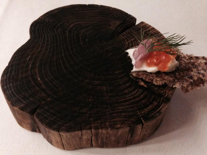Amuse bouche with roe and flaxen wafer.